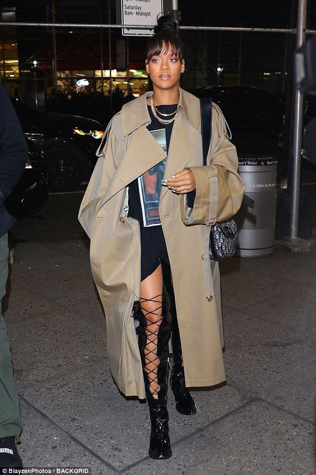 Rihanna sports oversize trench coat and top knot i