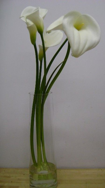 This Is A Floral Arrangement That Features Large White Calla Lilies See Our Entire Selection At Www Star Beautiful Centerpieces Calla Lily Floral Arrangements