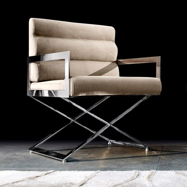 Capital Decor // Kappa Armchair - Italy  Criss-Crossed High polished steel legs and Leather or Fabric Upholstered seating. A contemporary piece with some Decó influence, make this a timeless piece for dining, living rooms or elegant home offices.
