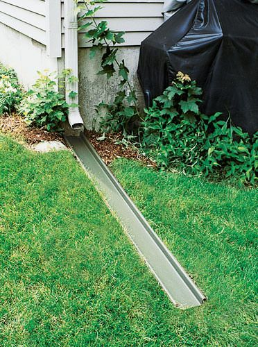 A gutter downspout extension installed in a getzville lawn for Yard drainage options
