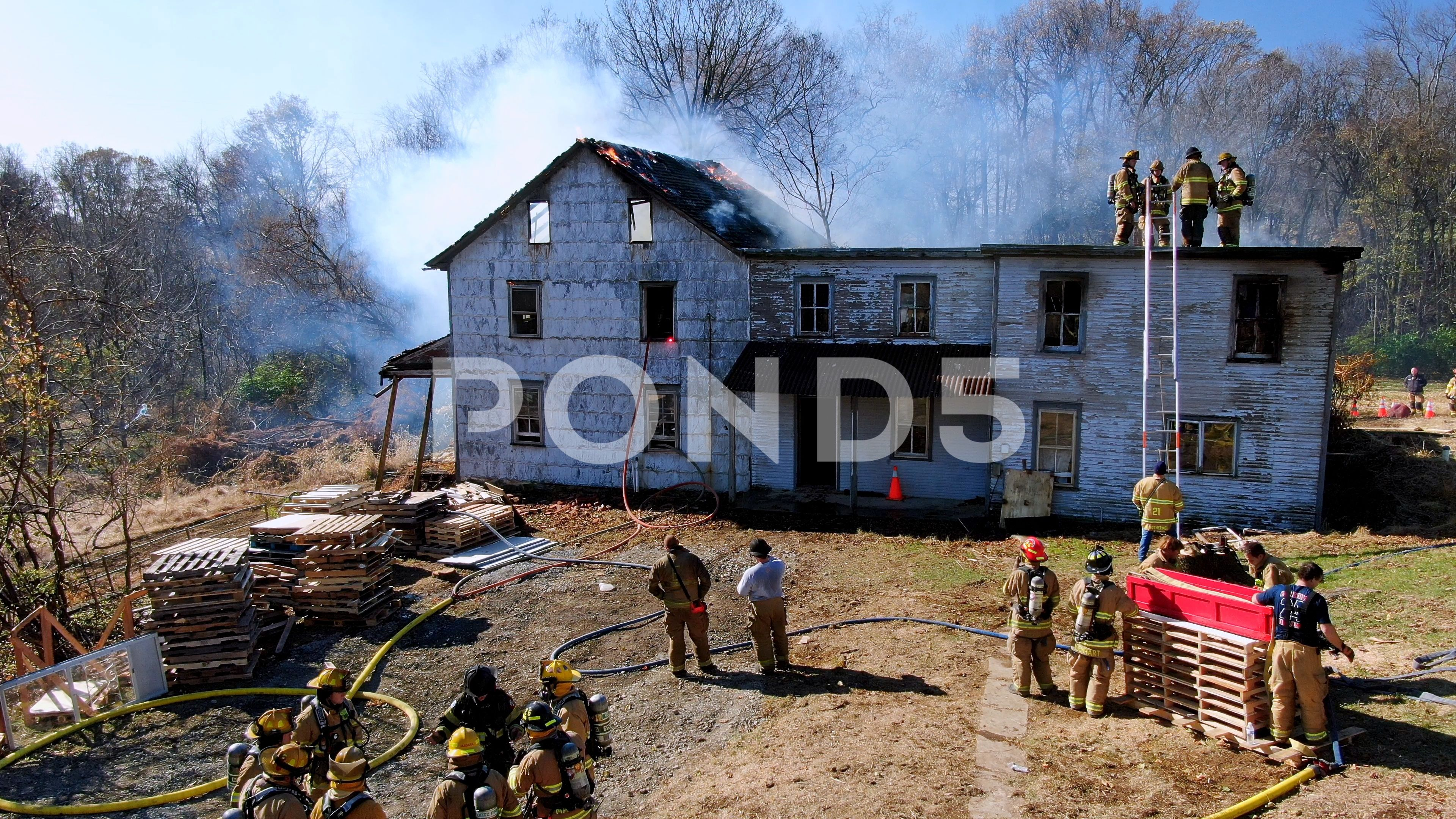 Firefighters respond to fire scene, wooden house in smoke and flames with Stock Footage #AD ,#scene#wooden#fire#Firefighters