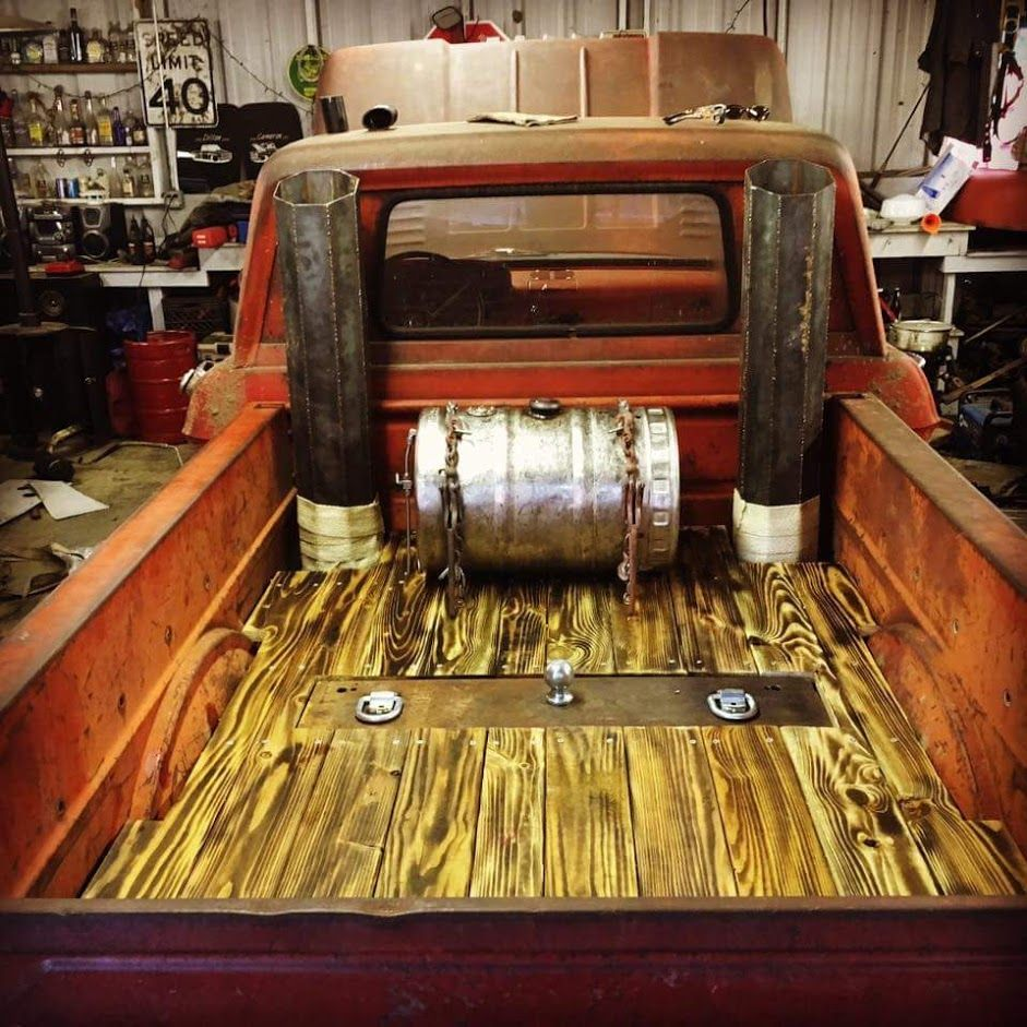Torch accented wood bed floor with dual exhaust stacks and a beer keg gas tank