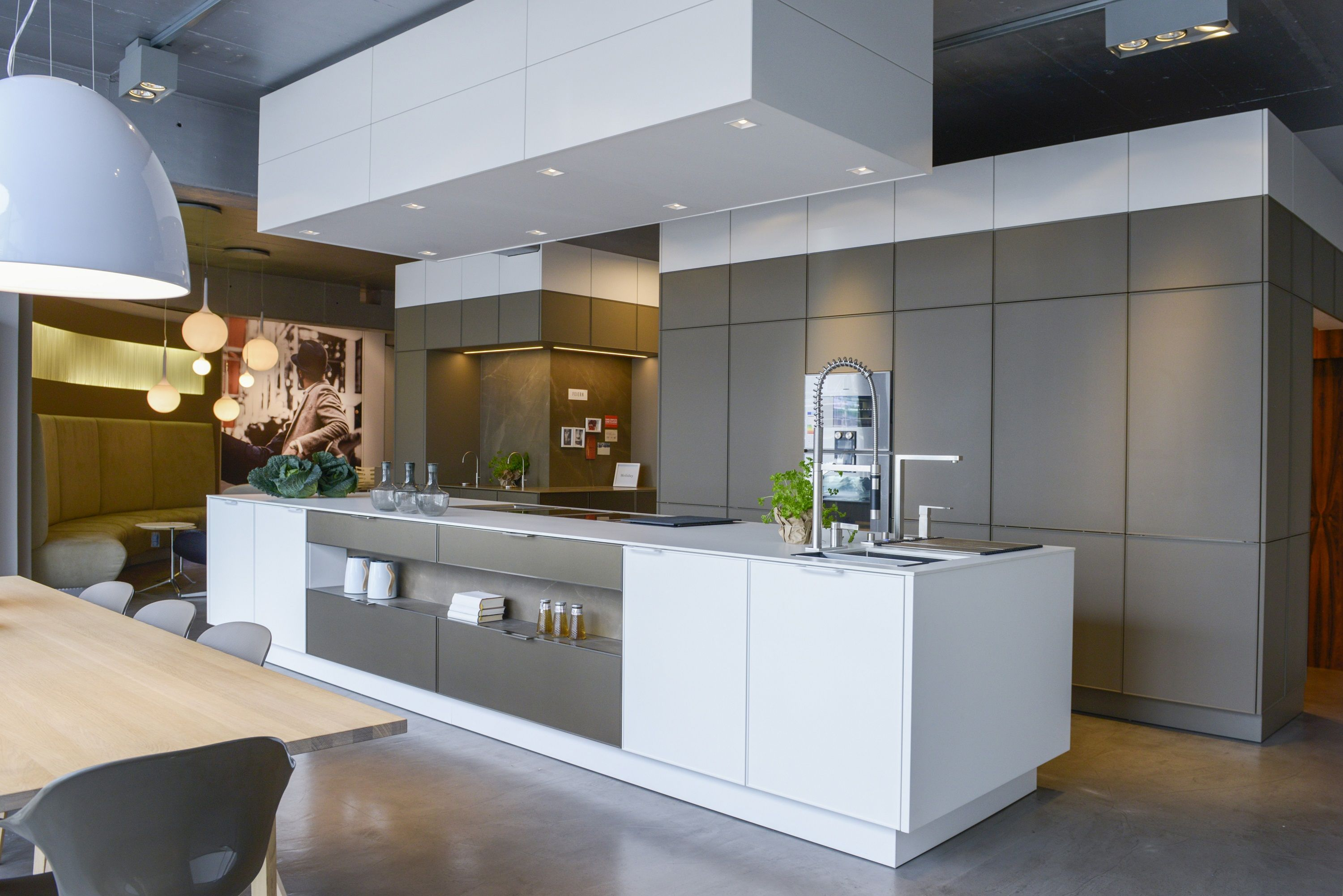SieMatic in gold bronze brings sleek yet comfortable tones to a an open kitchen