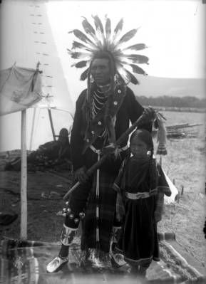 Flathead Chief Eagle poses with a young girl on the Flathead Indian Reservation in western Montana, ca. 1905-1907
