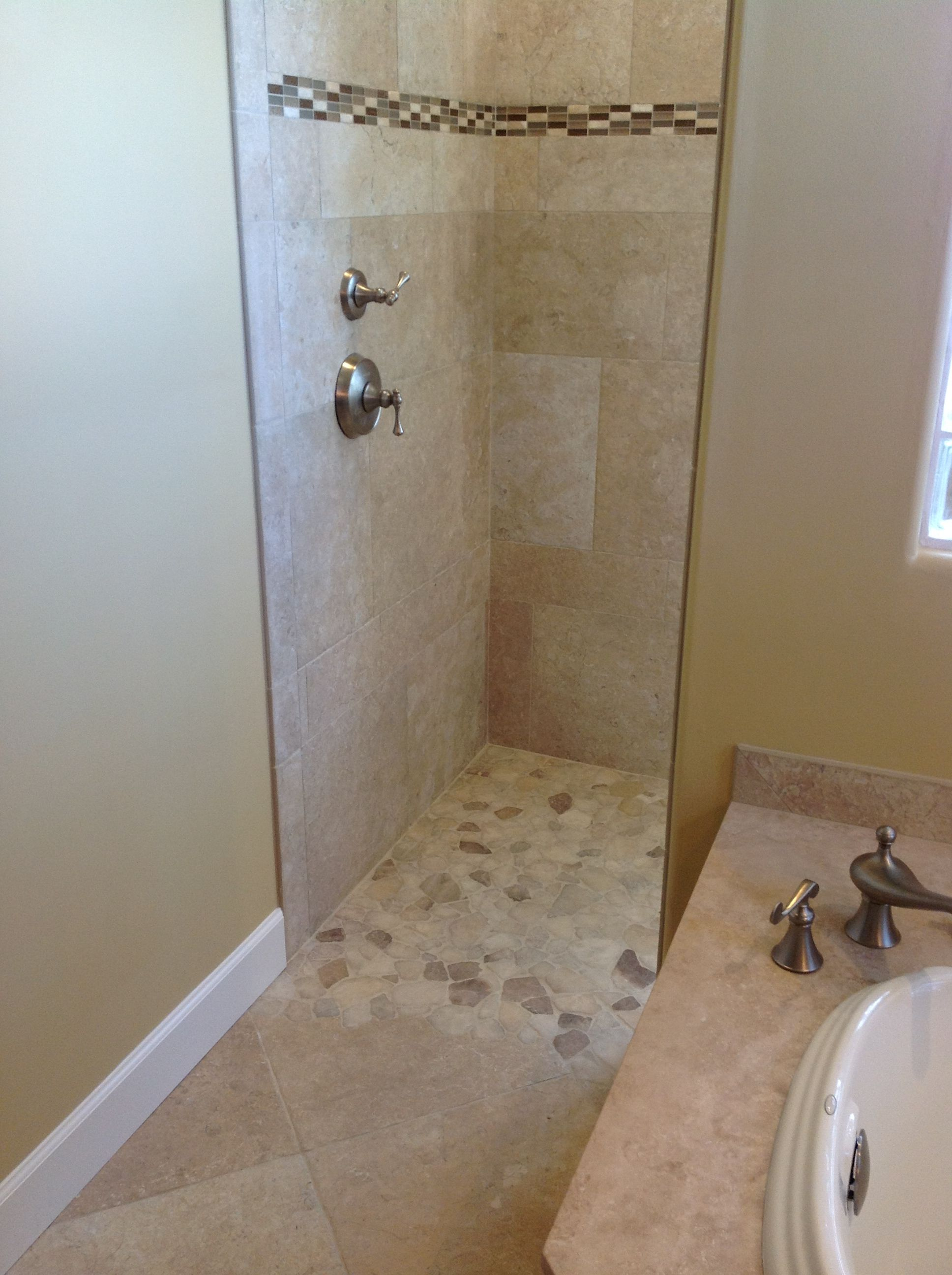 Custom walk in shower made of italian stone with a cool mosaic and custom walk in shower made of italian stone with a cool mosaic and large onyx floor dailygadgetfo Image collections