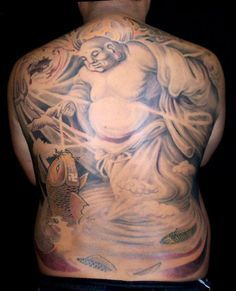 Full Back Tattoo Of Buddha And An Oasis Buddha Fishing Evidently