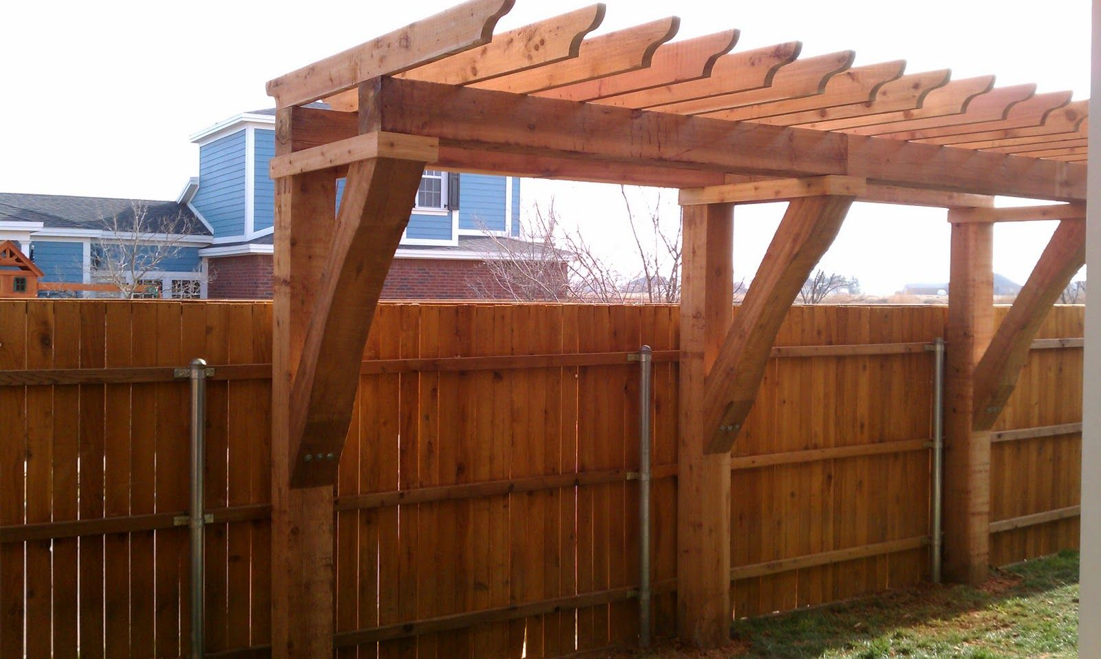 pergola coming off of back wall extending as far as possible to
