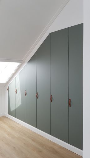 Gorgeous built-in closet under sloped ceiling