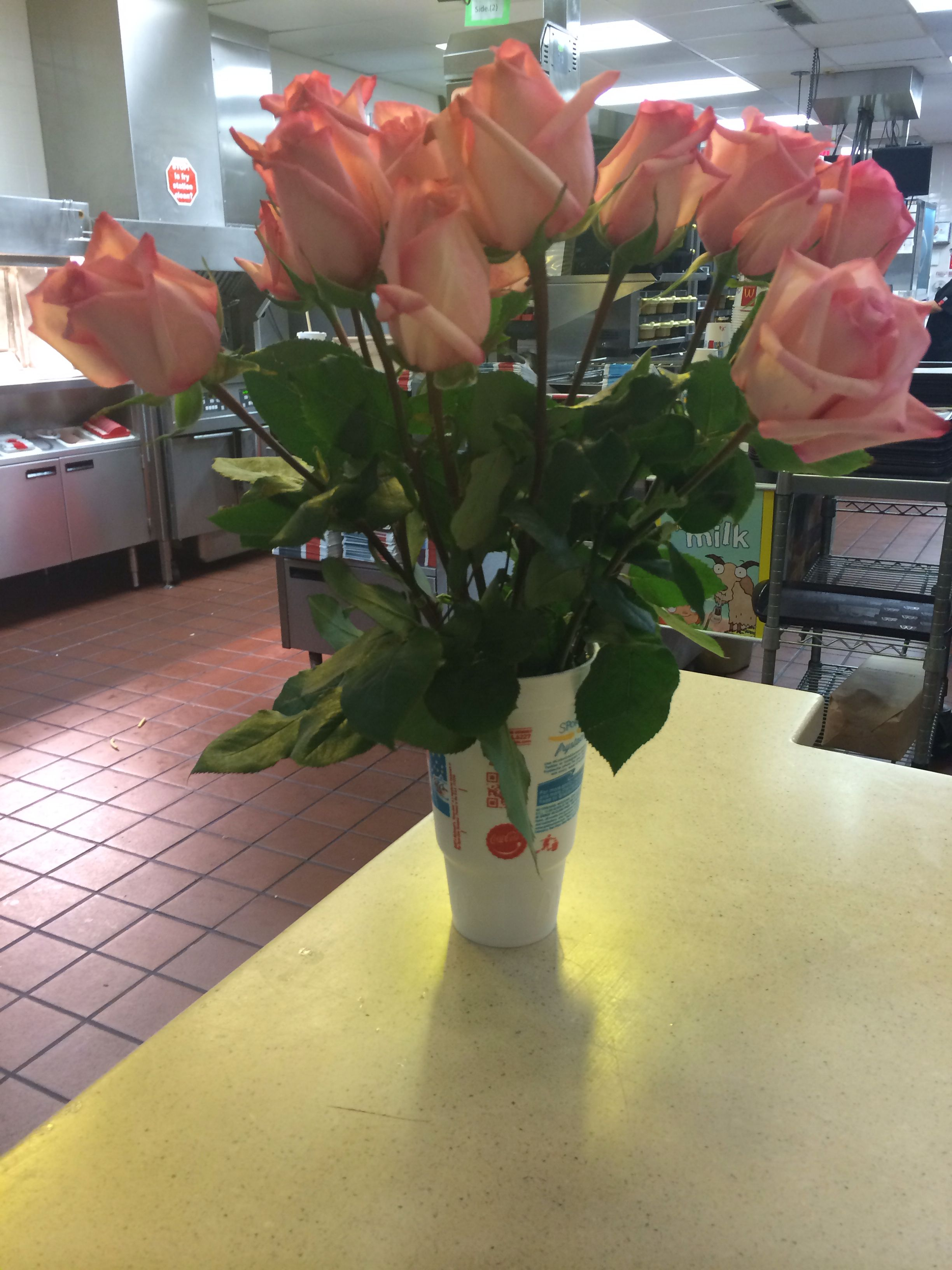 """Some guy came through the drive thru asked me what my name was.  I rudely replied """"my name tag says rose"""".  Then later someone gives my manager a dozen roses in the drive thru for a girl named rose.  I am taken proudly but it was a sweet thought!"""