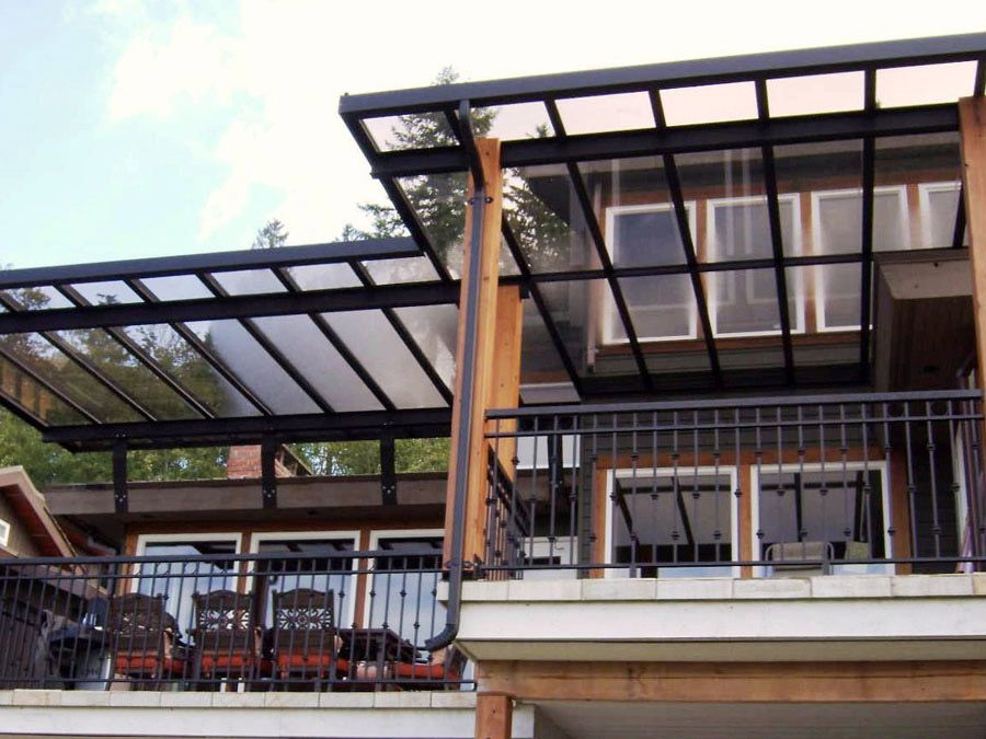 Contemporary house balcony equipped with modern chairs for Balcony roof ideas
