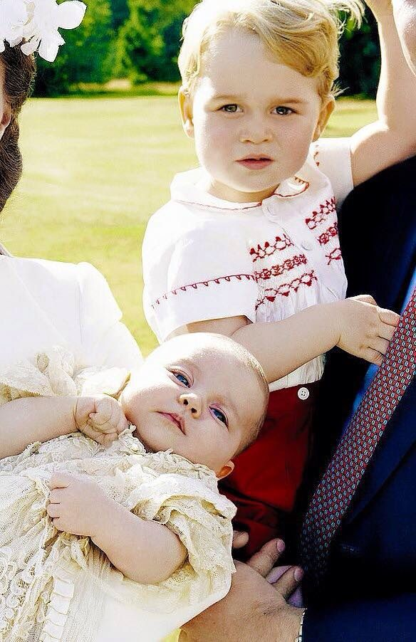Kate holding Charlotte with George next to her.