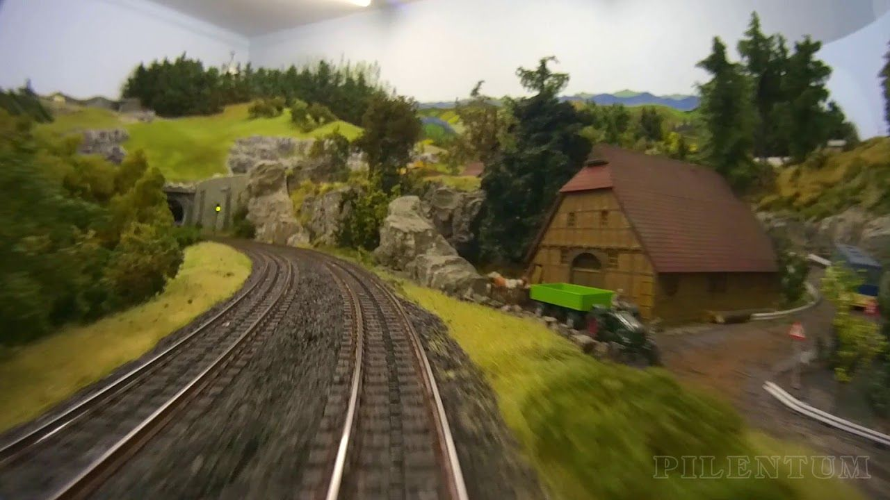 Cab ride on a model railroad layout with hidden railway station in