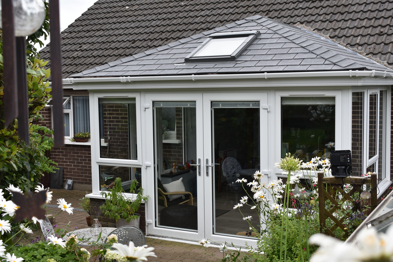 Budget Designer Homeworks Traditional Sunroom Sunroom Open Plan Living Living Styles