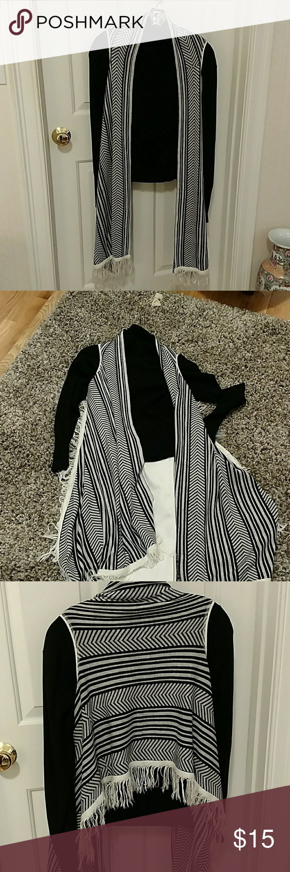 Black &white Fringe Vest Never worn. Super soft.  Falls right above the butt in the back with long panels in front.  Acrylic. BCBGeneration Sweaters