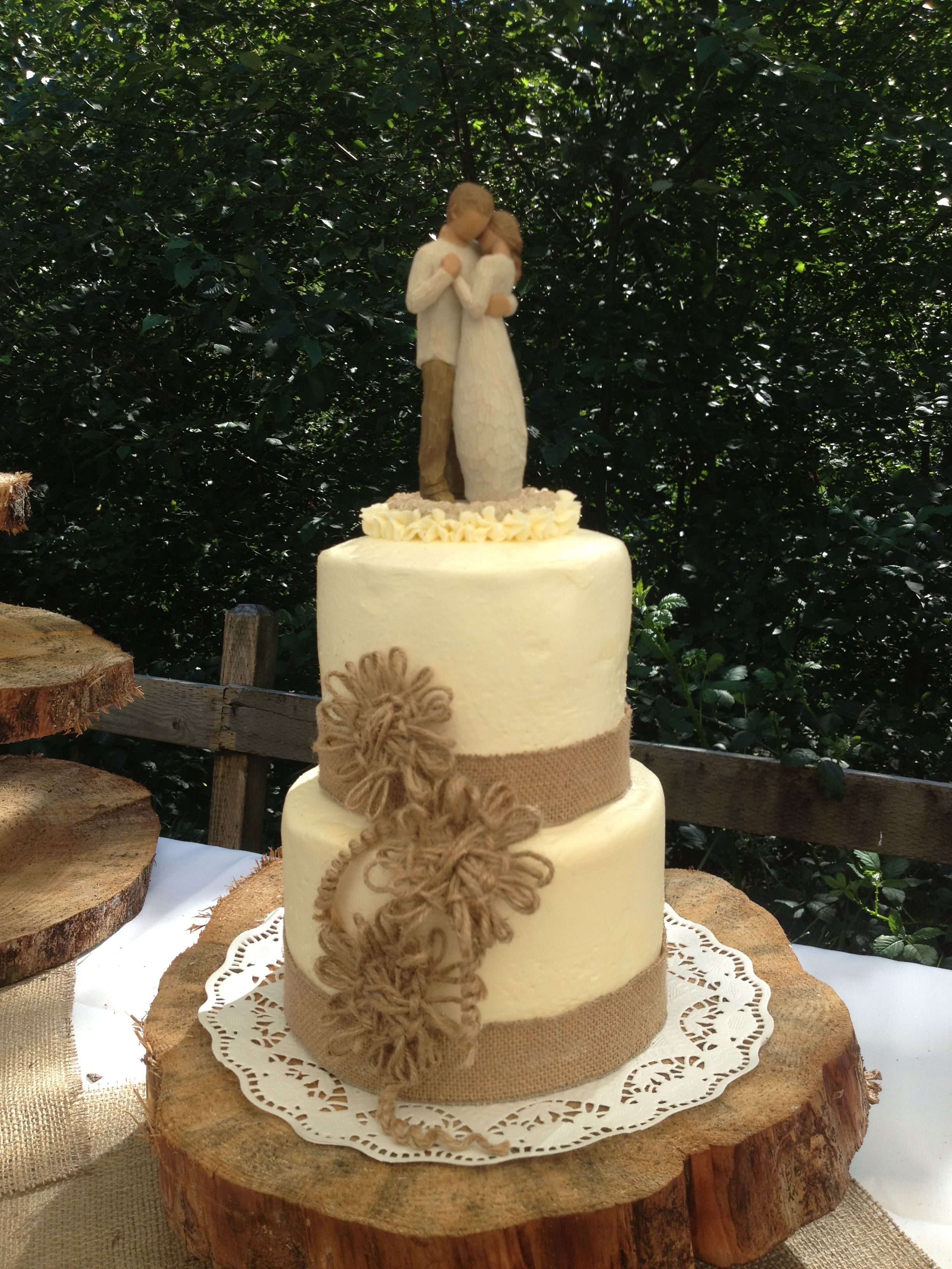 Rustic elegance wedding cake with burlap lace and twine flowers