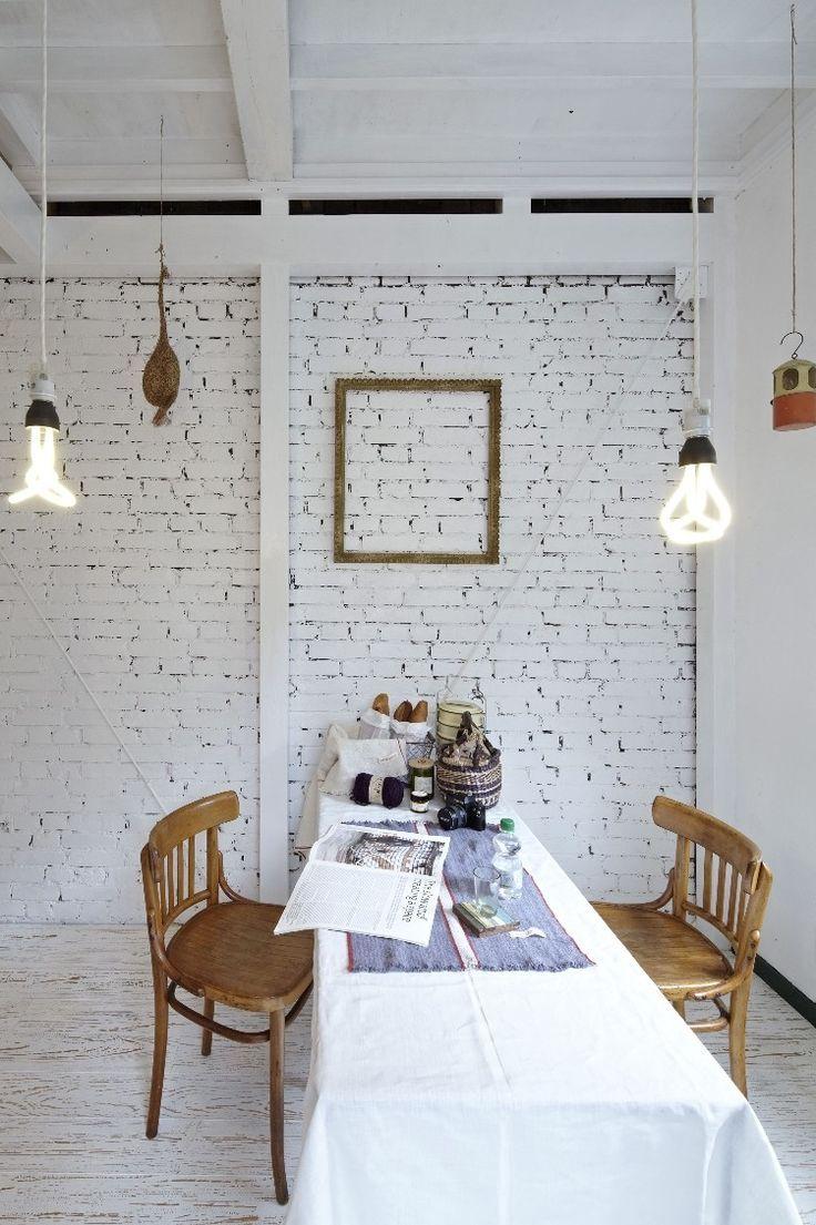 Dining Room Featuring White Bricks