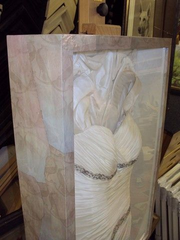 frame wedding dress....since it was ripped at the reception...find a ...