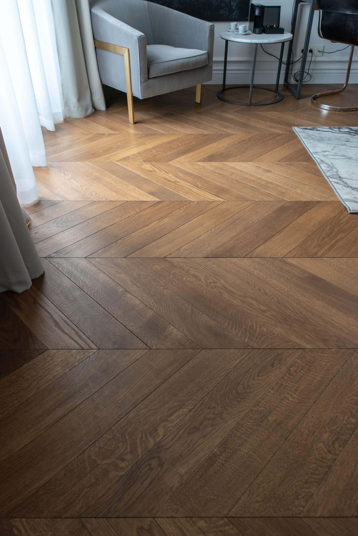 Light smoked engineered wood chevron parquet flooring