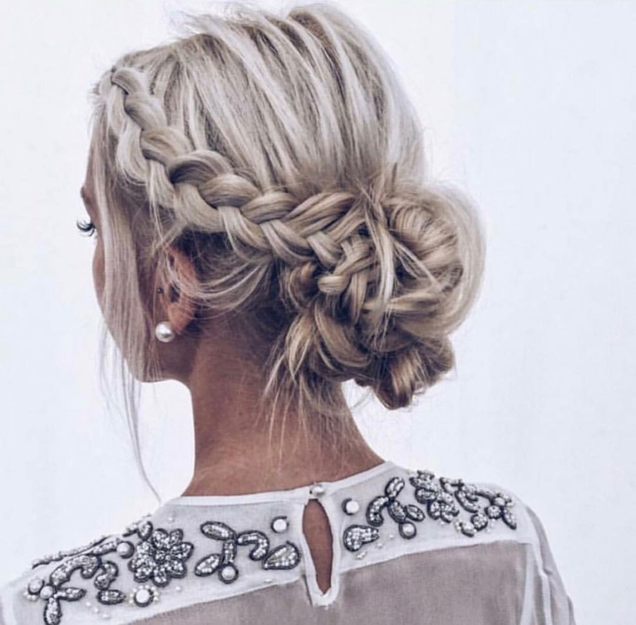 The perfect braided updo teased messy side braid fading into a low