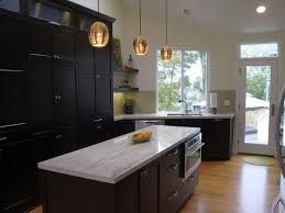 Image result for kitchens with dark cabinets and calcutta ...