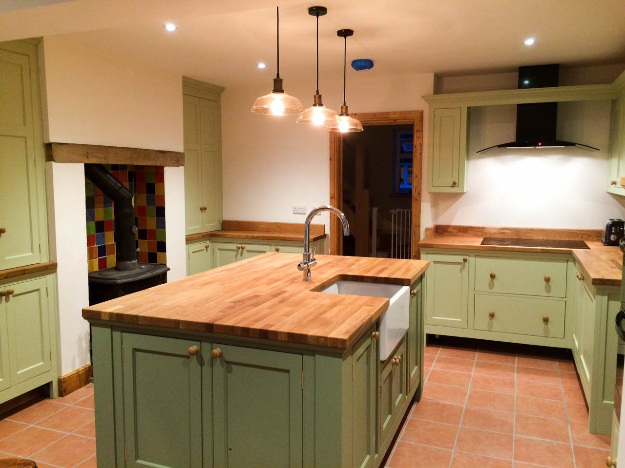 painted kitchen with freestanding island unit with belfast ...