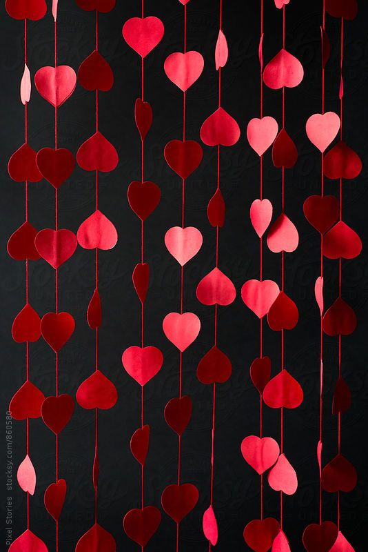 Diy red hearts curtain over black background by Pixel Stories