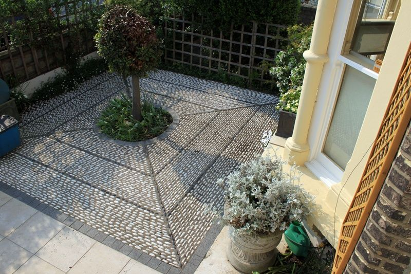 Pebble mosaic front garden with tree as a focus point for Mosaic landscape design