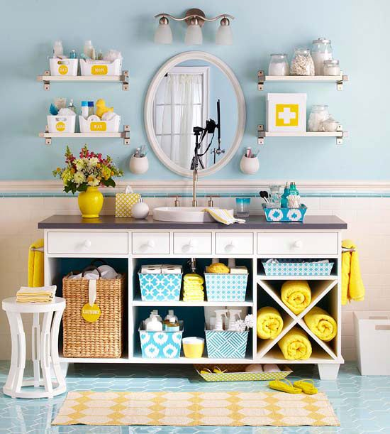 Help a small bath look and feel larger by removing the cabinet doors on an existing vanity. Add shelves as needed to keep the cabinet interiors neat and organized. Fill the shelves with color-coordinated baskets, storage bins, and bath towels to give the open cabinetry a cohesive look.