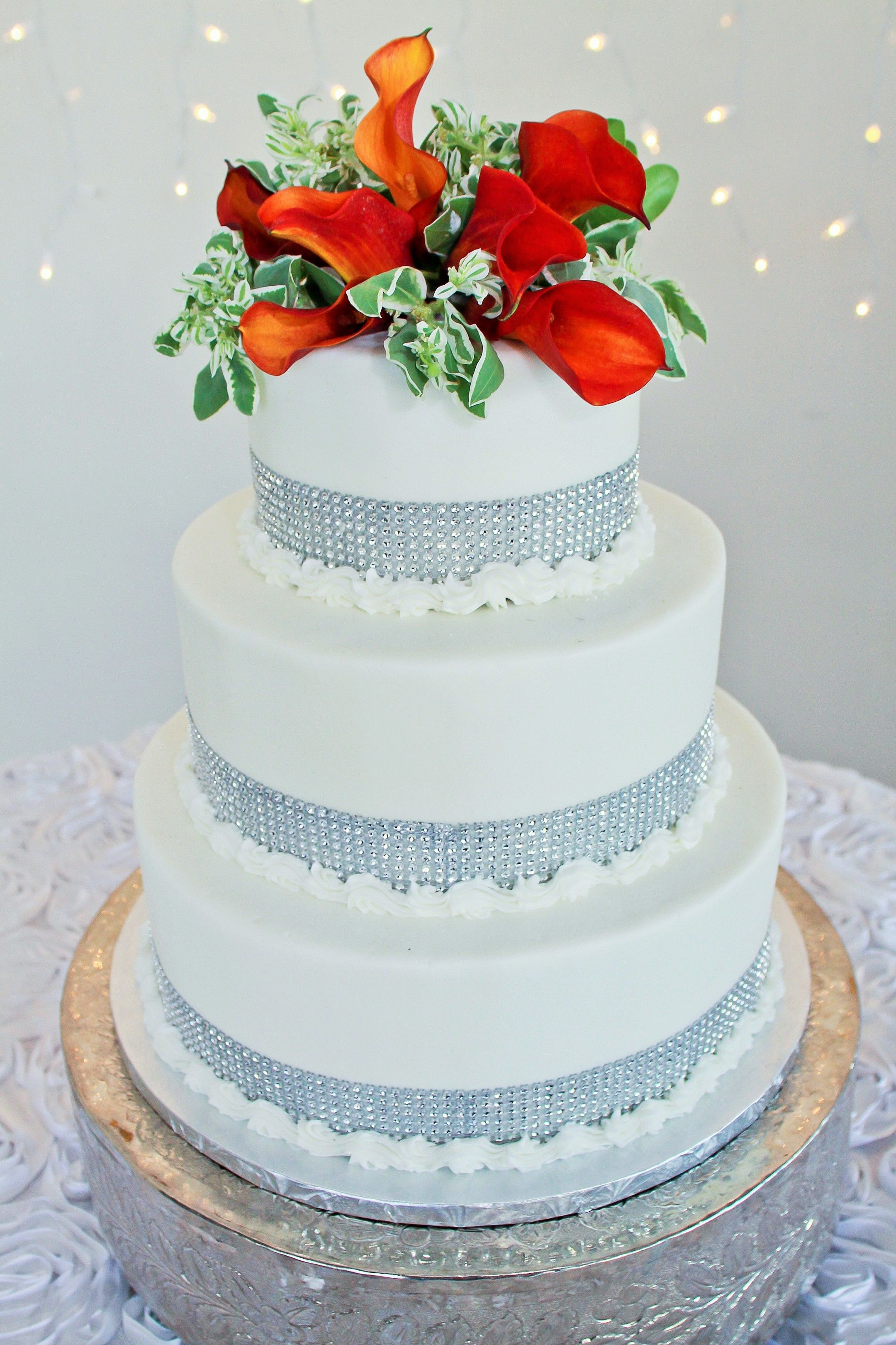3 Tier Round Wedding Cake with Silver Jeweled Ribbon and Orange ...