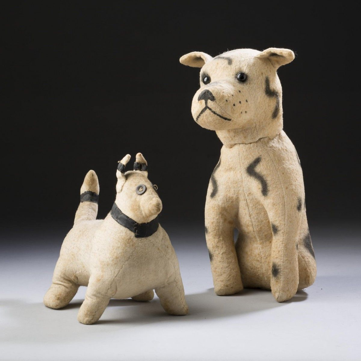 Stuffed beige cloth dog of muscular proportion, and a