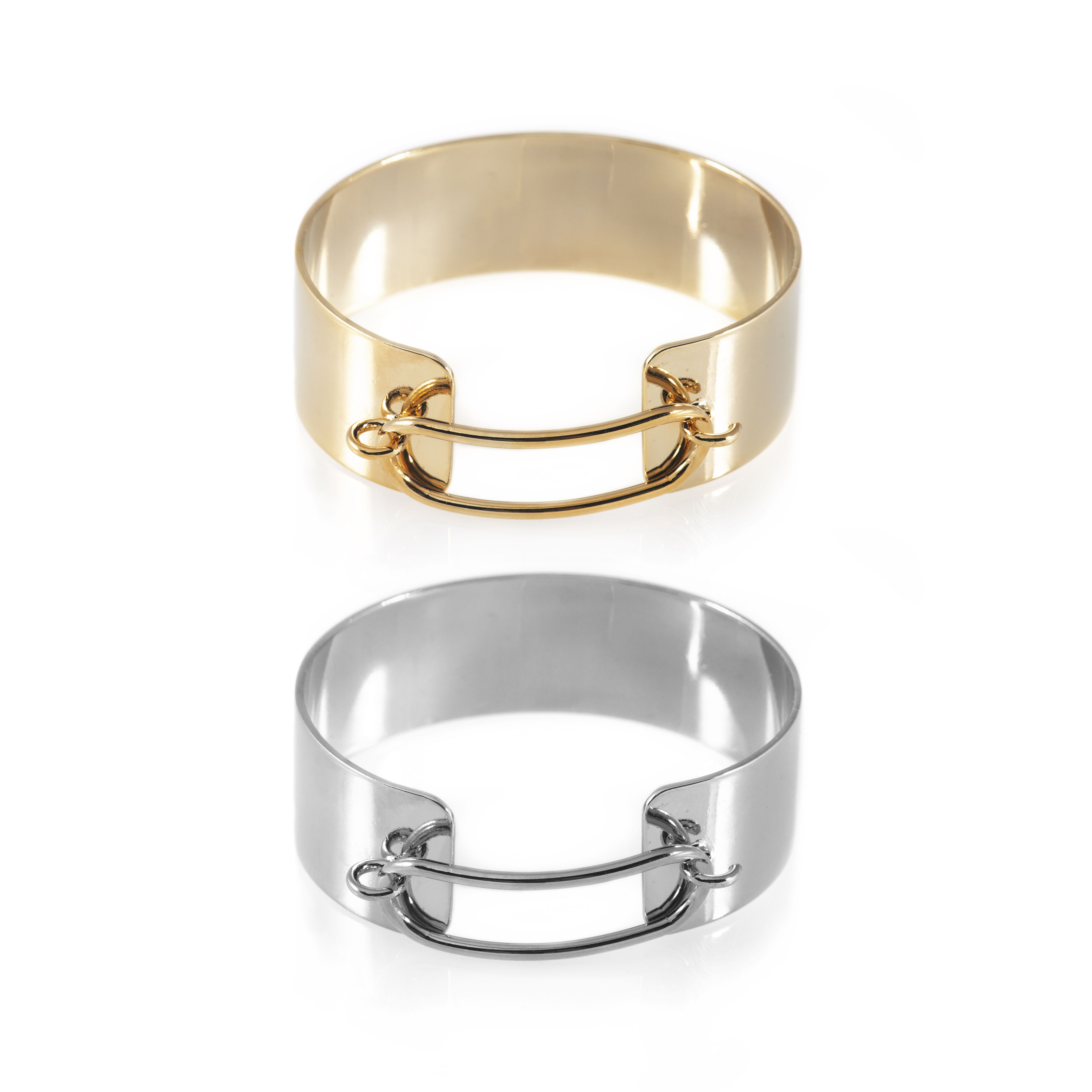 Up your jewel game with the Hook Cuff, which features 14K plating and fastens…