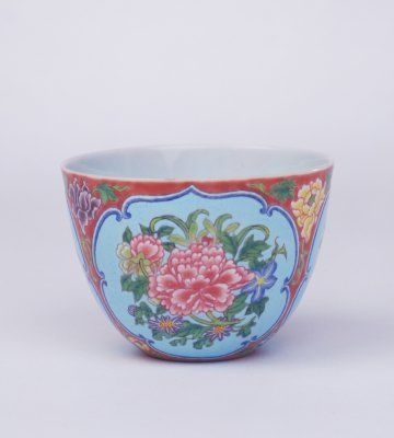 Cup with Peony Patterns in Reserved Panels in Enamel over a Red Ground