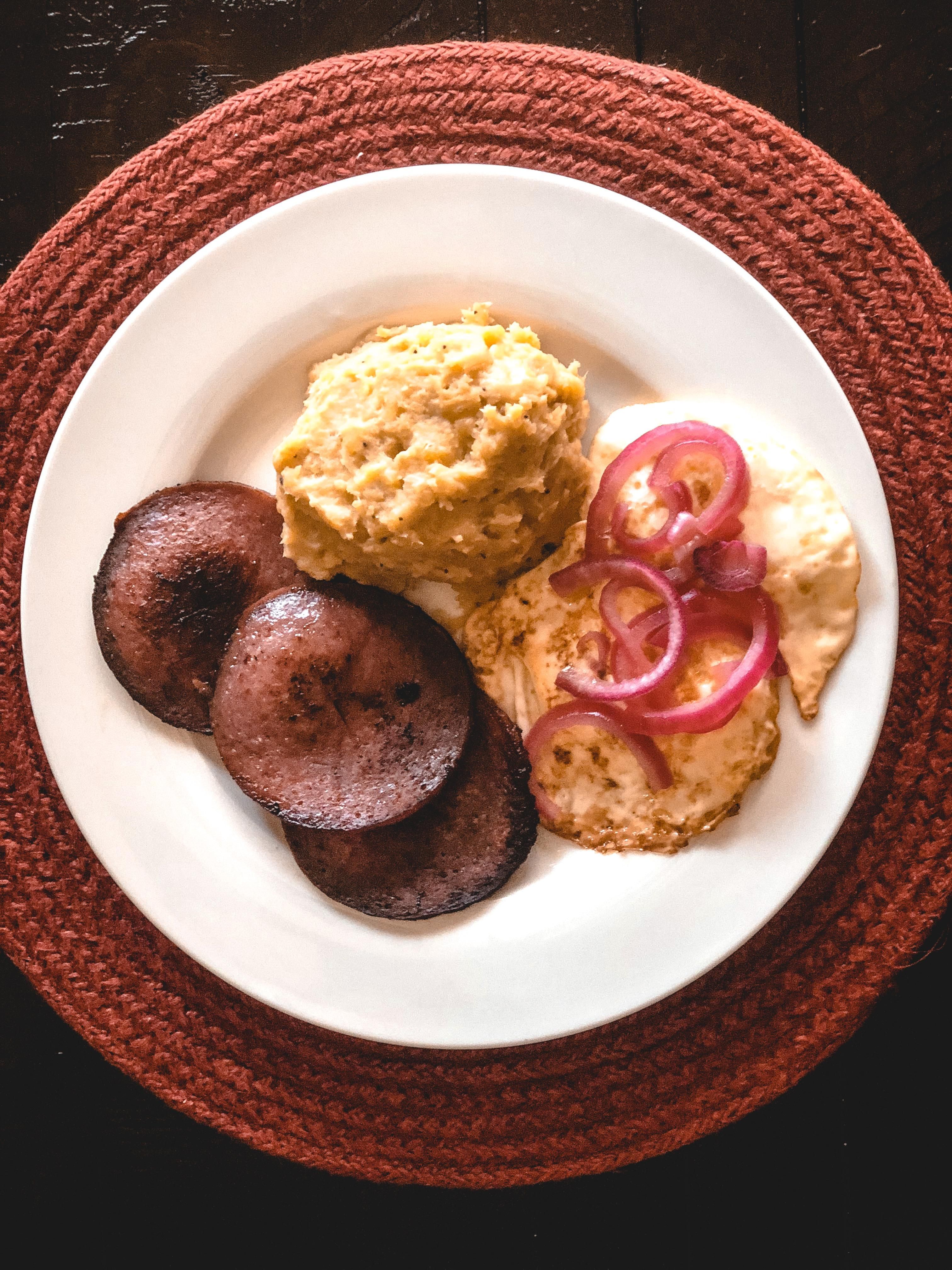 homemade dominican breakfast mangu boiled and mashed plantains with fried salami and eggs topped with red on in 2020 mashed plantains food pinterest