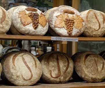 Boulangerie Poilâne In 1932, Pierre Poilâne, a young baker from Normandy, opened his first shop on the rue du  Cherche-midi. A few years later, he invented a round loaf that revolutionised the industry. The  bread stayed fresh longer and could be cut into large slices to make the famous 'tartines'.  Decades later, the round loaf is still the best-seller and its fabrication remains the same.