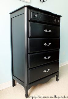 A Black French Provincial Dresser