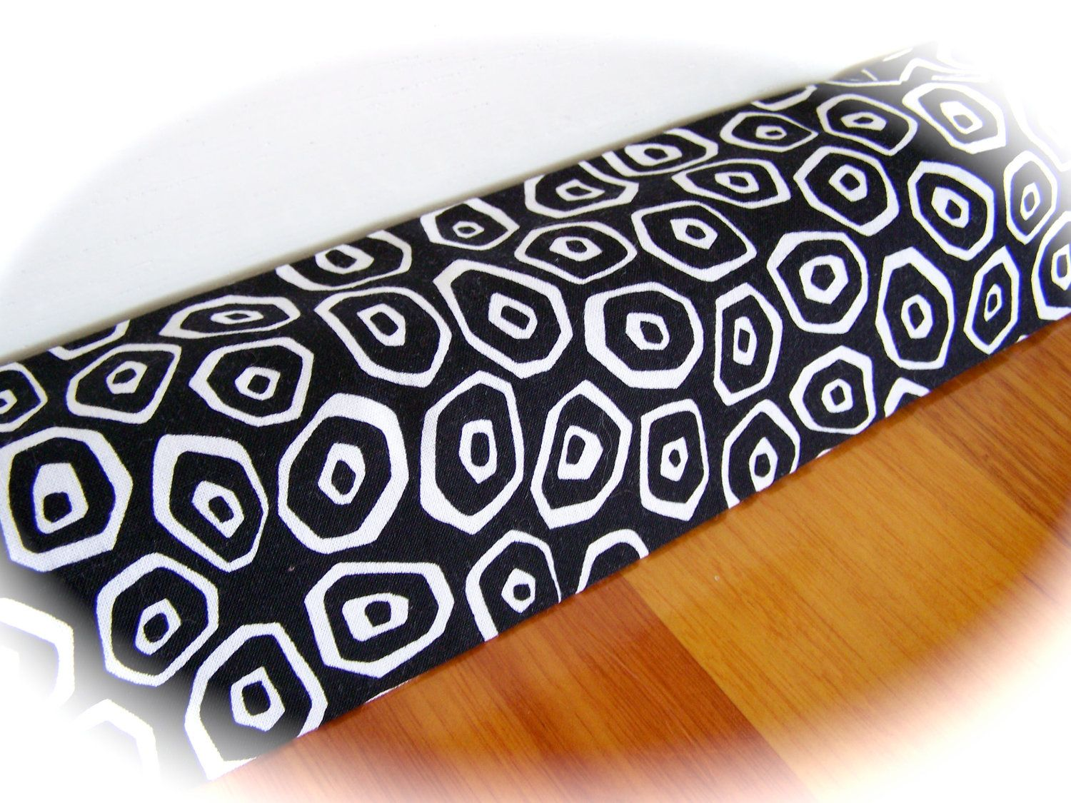 Draft Stopper, Draught Excluder, door snake, sausage, NEW Cover for kitchen door. - Black and white circles. $11.50, via Etsy.