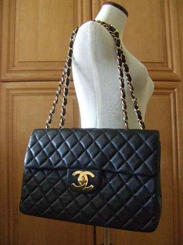 CHANEL- Jumbo flap bag in black lambskin  029f25e0087