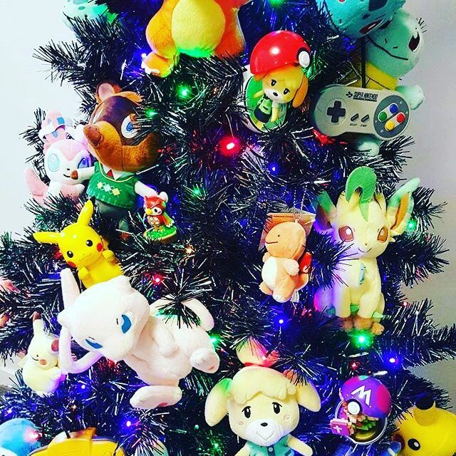 This merry Christmas tree is by @eeveeemmy. Love the idea you've made it work really well!!  I turned our Christmas Tree into a #nintendo fire hazard