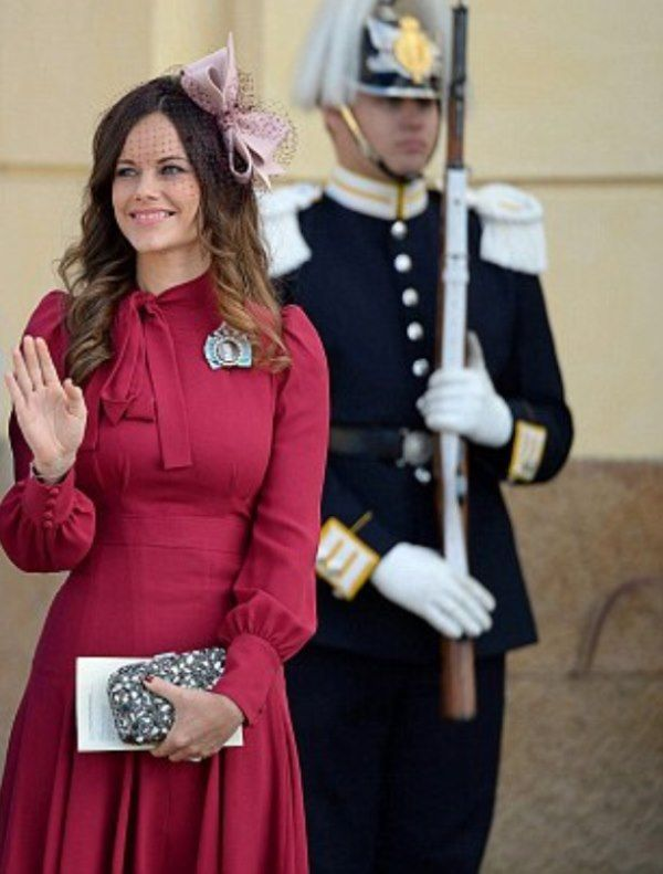 Princess Sofia of Sweden in a Gucci silk-crepe autumnal burgundy shade dress with a pretty pussybow neck  she wore last weekend, October 11, 2015 at the christening of Prince Nicolas at Drottningholm Palace Chapel in Stockholm, Sweden.