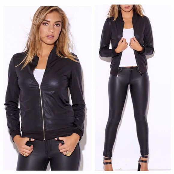 Faux Leather Coated Edgy Bomber Jacket This timeless piece is made for anyone to treasure for a long time.  You will find yourself wearing it all year long! This modern and chic bomber is great for the AM with jeans or even suiting pants for work.  You can throw it over a mini dress for nights out to spice up any outfit in an instant.  Be prepared for endless compliments!  Unlined, stretchy Made in the USA Model is 5'10 Bust: 34, Waist: 26, Hipe: 35, wearing a size small Jackets & Coats