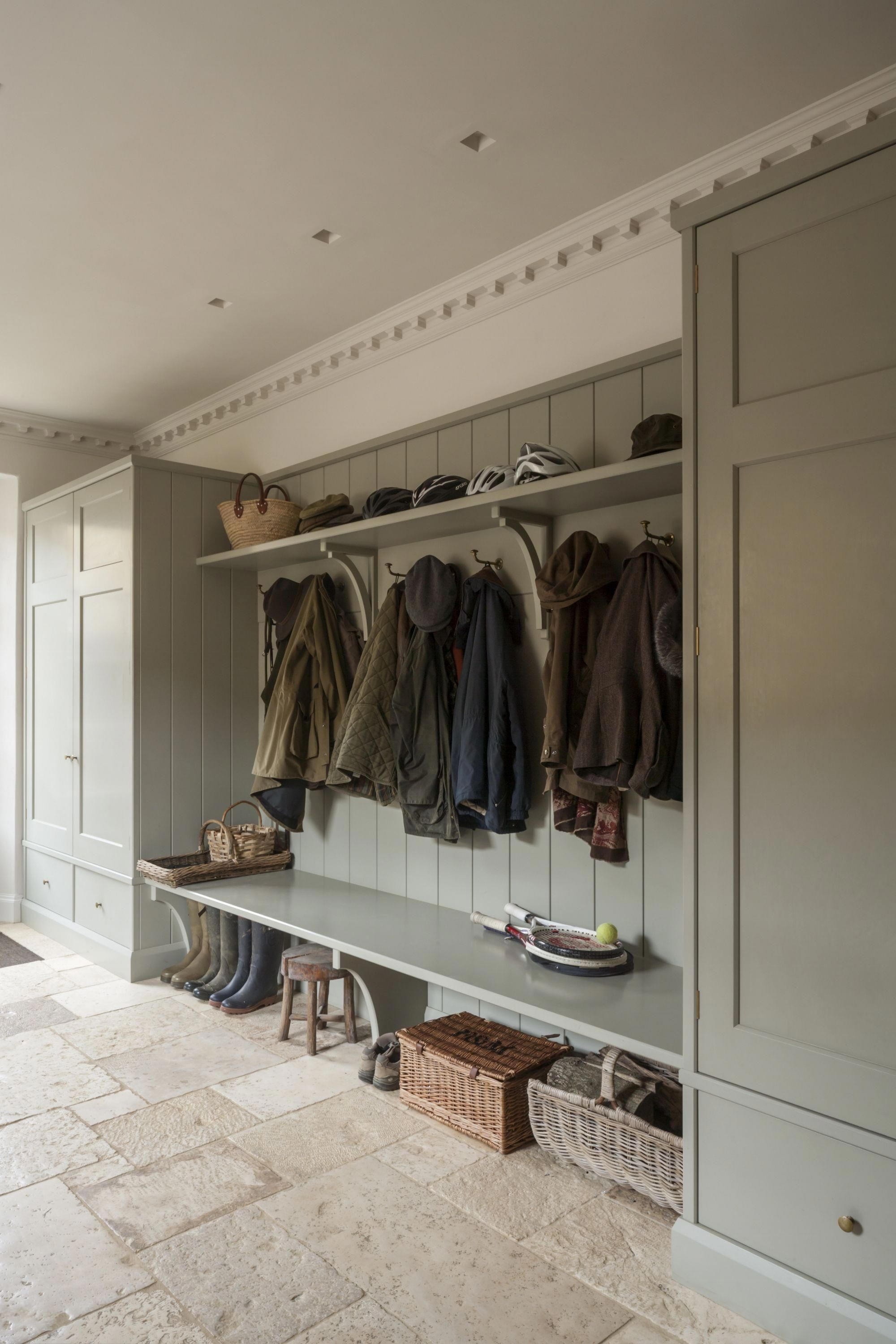 bespoke painted bootroom with fitted cupboards, storage