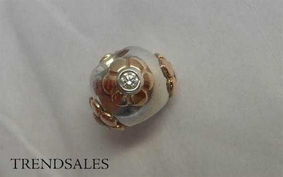Pandora - lovely charm with four 14 kt. gold flowers and zirkonia - 790207CZ. Retired.