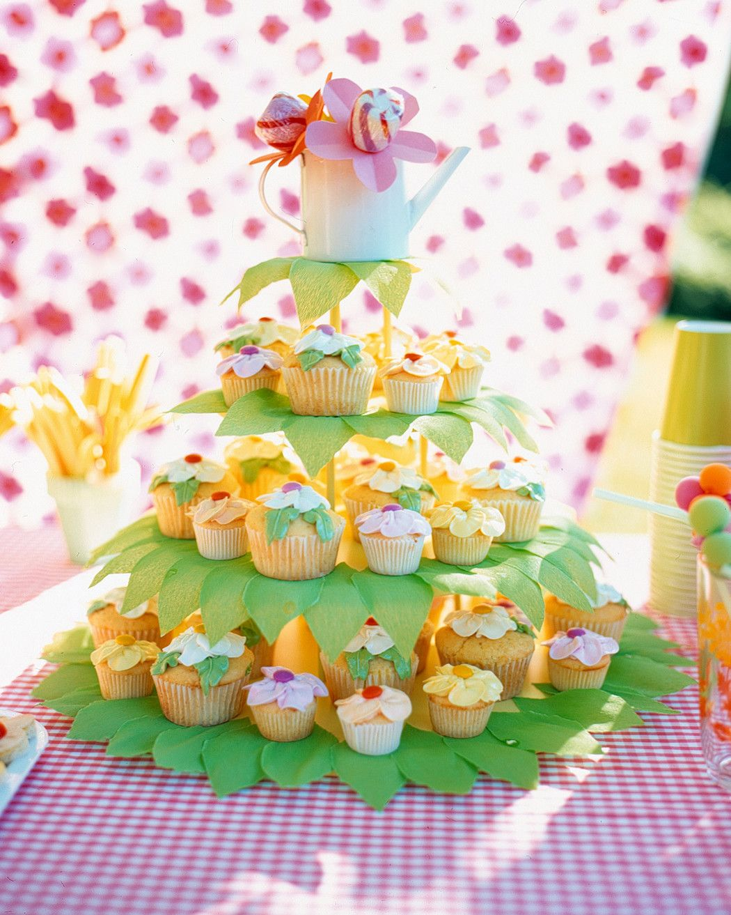 Mimic Your Spectacular Summer Garden With An Array Of Colorful Flower Cupcakes Arrange Them On A Cake Stand Decorated In Green Crepe Paper Leaves For