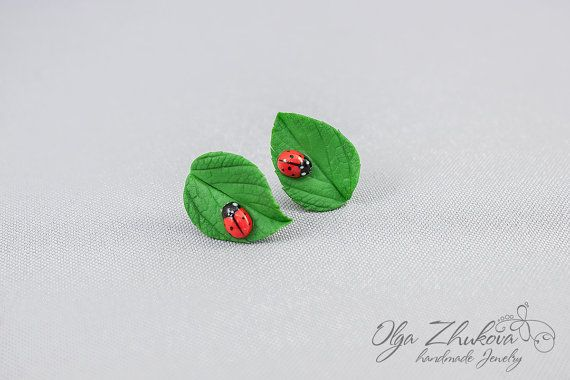 Stud earrings with green leaves made of polymer by polymerFlowers