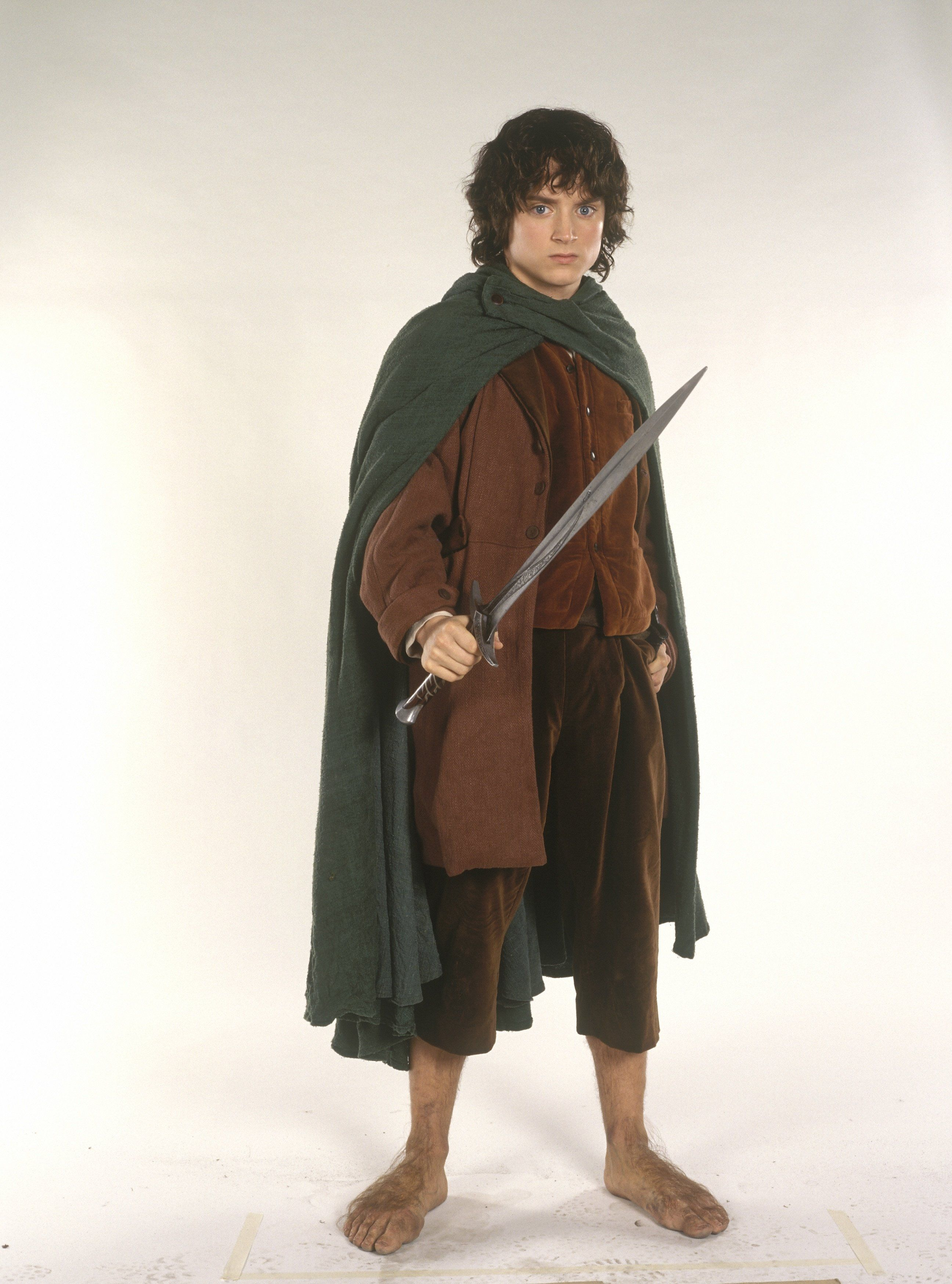 Elijah Wood as Frodo holding the ring Lord of the Rings 8 ...   Elijah Wood Frodo Poster