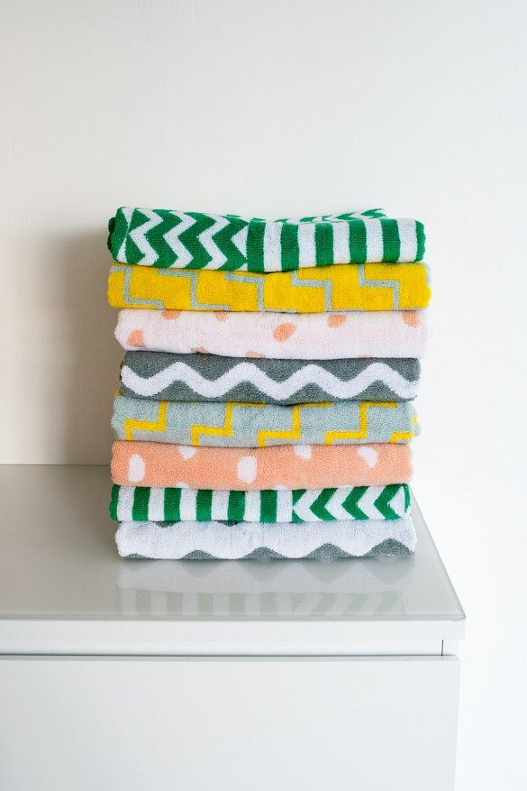 Geometric-printed towels in various colors by Dusen Dusen