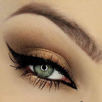 Bronze, gold, and brown eyeshadow shades create a simple yet dramatic look. DIY this sultry eye makeup on your next formal event!