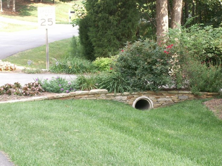 Driveway entrance landscaping ideas drainage pipe for Drain pipe landscaping