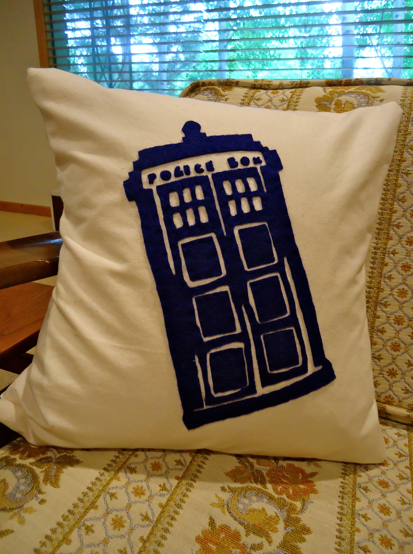 TARDIS pillow.  Hand cut and sewn.  Labor of love.  Based off of this pin: http://pinterest.com/pin/99571841731407349/