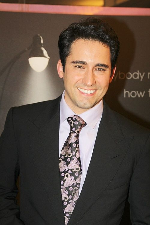 John Lloyd Young suit and wonderful tie with full windsor knot